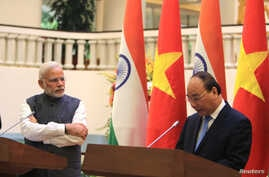 "Indian Prime Minister Narendra Modi, left, listens to Vietnamese Prime Minister Nguyen Xuan Phuc during a press conference in Hanoi, Vietnam, Sept.3, 2016. The two countries have agreed to upgrade a ""strategic partnership,"" giving Vietnam more Indian"