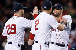 Boston Red Sox's Daniel Nava (29), Jacoby Ellsbury (2) and Shane Victorino celebrate after the Red Sox defeated the St. Louis Cardinals, 8-1, in Game 1 of baseball's World Series, Oct. 23, 2013.