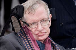 """FILE - Professor Stephen Hawking arrives for the """"Interstellar Live"""" show at the Royal Albert Hall in London, March 30, 2015. Hawking, whose brilliant mind ranged across time and space though his body was paralyzed by disease, March 14, 2018, at age"""