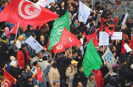 Several thousand supporters of Tunisia's ruling moderate Islamist party rally in a pro-government demonstration in the capital Tunis, February 9, 2013.