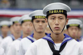 Taiwan Navy sailors stand in attention during the commissioning ceremony of two U.S.-made Kidd class destroyers, Thursday, Nov. 2, 2006, at the naval harbor or Suao, northeast Taiwan.
