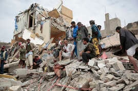 People inspect the rubble of houses destroyed by Saudi-led airstrikes in Sanaa, Yemen, Friday, Aug. 25, 2017. Airstrikes by a Saudi-led coalition targeted Yemen's capital early on Friday, hitting at least three houses in Sanaa and killing at least 14...