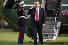 President Donald Trump salutes as he steps from Marine One to walk across the South Lawn of the White House in Washington, Aug. 23, 2017, as he returns from Reno, Nev.