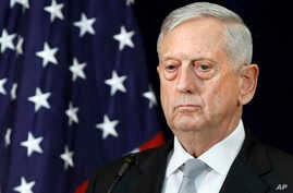 FILE - Defense Secretary James Mattis attends a news conference, Thursday, Aug. 17, 2017, at the State Department in Washington.