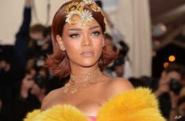 """Rihanna arrives at The Metropolitan Museum of Art's Costume Institute benefit gala celebrating """"China: Through the Looking Glass"""" on May 4, 2015, in New York."""