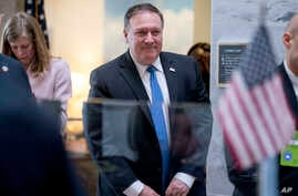 Secretary of State nominee Mike Pompeo leaves a meeting with Sen. Angus King, I-Maine, on Capitol Hill in Washington, April 9, 2018.