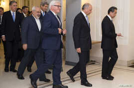 Britain's Foreign Secretary Philip Hammond, Iranian Foreign Minister Mohammad Javad Zarif, US Secretary of State John Kerry, German Foreign Minister Frank-Walter Steinmeier, French Foreign Minister Laurent Fabius and Chinese Foreign Minister Wang Yi