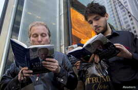 "People read as they wait in line for Republican presidential candidate Donald Trump to sign copies of his new book ""Crippled America"" in the Manhattan borough of New York, Nov. 3, 2015."