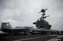 F-18 fighter jets are seen on the flight deck of the USS Harry S. Truman aircraft carrier in the eastern Mediterranean Sea, May 5, 2018.