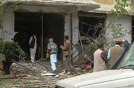 Pakistani security officials inspect a damaged building of a U.S.-based Christian charity after a militant attack near the town of Oghi in the Mansehra district of North West Frontier Province (NWFP), 10 Mar 2010