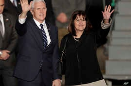 U.S. Vice President Mike Pence and his wife Karen wave as they landed at Tel Aviv airport Sunday, Jan. 21, 2018. Pence will pay a three day visit to Israel.