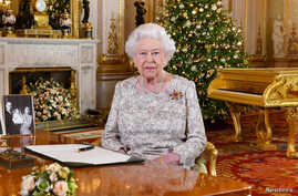 Britain's Queen Elizabeth poses, after recording her annual Christmas Day message, in the White Drawing Room of Buckingham Palace, London, in this undated picture released Dec. 24, 2018.