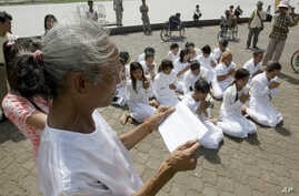 FILE - Rape victims who never received hearings for allegations pray in front of Royal Palace, Phnom Penh, Cambodia.