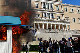 Greek Police, Anti-Austerity Protesters Clash in Athens