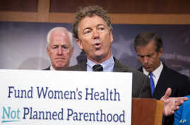 Senator Rand Paul, R-Ky. (Center), with Senators John Cornyn, R-Texas (Left), and John Thune, R-S.D., speaks about Planned Parenthood, on Capitol Hill in Washington, July 29, 2015.