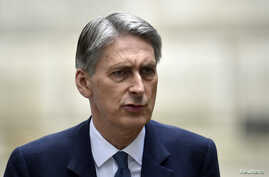 FILE - British Foreign Secretary Philip Hammond says seizing West Bank land would 'do serious damage' to Israel's international standing.