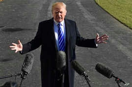 FILE - In a Saturday, Dec. 16, 2017 file photo, President Donald Trump talks with reporters as he departs from the South Lawn of the White House via Marine One in Washington, to spend the weekend at Camp David in Maryland.
