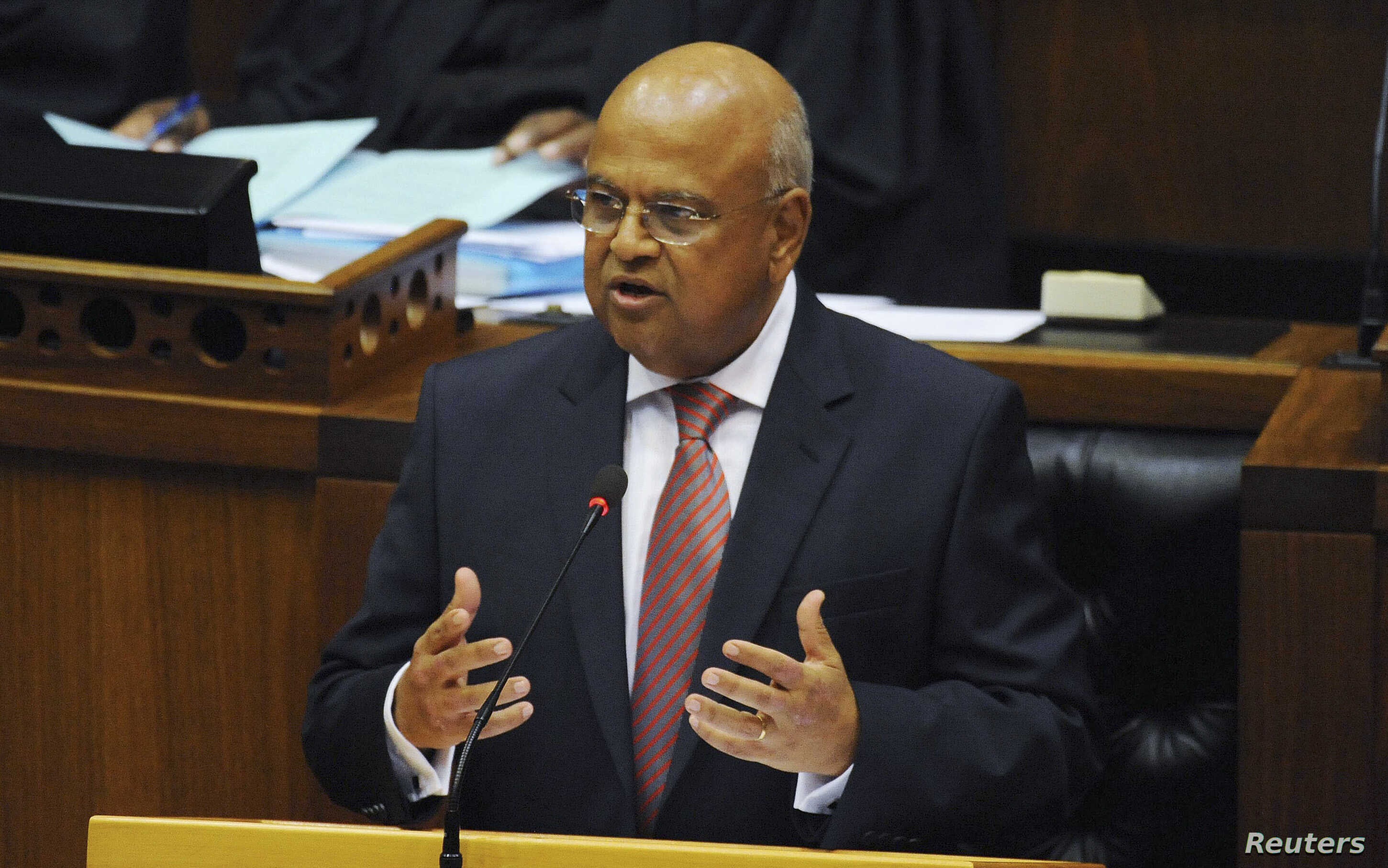 FILE - South African Finance Minister Pravin Gordhan delivers his 2013 Budget speech at Parliament in Cape Town, Feb. 27, 2013.