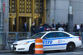 An NYPD car is seen outside Manhattan's federal court where Nazih al-Ragye, known by the alias Abu Anas al-Liby, is expected for arraignment in New York, Oct. 15, 2013.