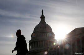 A visitor walks by the U.S. Capitol during a partial government shutdown in Washington, Jan. 22, 2019.