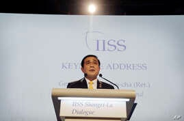 Thailand's Prime Minister Prayuth Chan-ocha delivers the keynote address at the Opening Dinner of the 15th International Institute for Strategic Studies Shangri-la Dialogue, or IISS, Asia Security Summit on Friday, June 3, 2016, in Singapore.