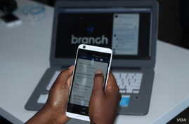 Branch is a microlender that provides financial services, including loans, to Kenya residents via their mobile phones. (L. Ruvaga/VOA)