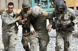 Members of �Dustoff� medevac team from 101st Airborne Division, 101st Combat Aviation Brigade, Task Force Shadow help an Afghan soldier and a U.S. soldier injured from a roadside bomb blast, 18 Sep 2010 Reuters Image)