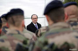 French President Francois Hollande (Rear) inspects a group of French soldiers at the Iraqi Counter Terrorism Service Academy on the Baghdad Airport Complex in Baghdad, Iraq, Jan. 2, 2017.