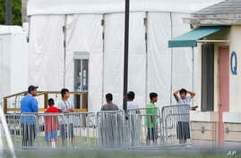FILE - Immigrant children walk in a line outside the Homestead Temporary Shelter for Unaccompanied Children, a former Job Corps site that now houses them in Homestead, Fla., June 20, 2018.
