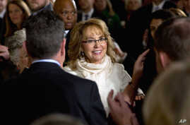 People applaud former Arizona Rep. Gabby Giffords as she arrives in the East Room of the White House in Washington, to hear President Obama speak about steps his administration is taking to reduce gun violence, Jan. 5, 2016.