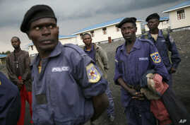 FILE - Policemen gather at a training center near the eastern Congolese town of Goma.