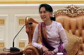 Myanmar's State Counsellor Aung San Suu Kyi smiles during a meeting with Hong Kong Chief Executive Carrie Lam at the Presidential Palace in Naypyitaw, Myanmar, Sept. 15, 2017. Facing growing condemnation globally, Aung San Suu Kyi will not attend U.N