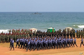 Sri Lankan security force members march during the annual victory day parade in Colombo, May 19, 2012.