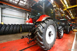 FILE - A general view shows the assembly line of the Minsk tractor works in Minsk, Belarus, May 29, 2016.