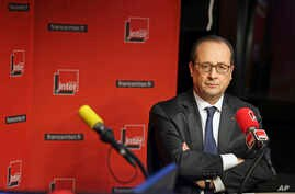 French President Francois Hollande is seen taking a question during an interview with radio station France Inter in Paris Jan. 5, 2015.