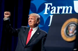 President Donald Trump pumps his fist after speaking at the American Farm Bureau Federation's Annual Convention at the Gaylord Opryland Resort and Convention Center, Monday, Jan. 8, 2018, in Nashville, Tenn.