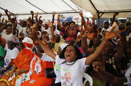 Woman gather at a local market area to celebrate the victory of Ivory Coast's President Alassane Ouattara after elections in Abidjan, Ivory Coast, Oct. 28, 2015.