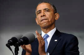 President Barack Obama applauds those who serve in Iraq and Afghanistan as he deliverers the commencement address to the U.S. Military Academy at West Point's Class of 2014, in West Point, N.Y., May 28, 2014.
