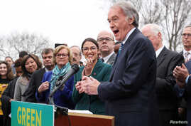 "FILE - Sen. Ed Markey, D-Mass., and Rep. Alexandria Ocasio-Cortez, D-N.Y.,  hold a news conference for their proposed ""Green New Deal"" to achieve net-zero greenhouse gas emissions in 10 years, at the U.S. Capitol in Washington, Feb. 7, 2019.  The Rep"