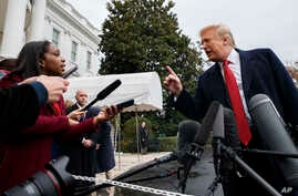 FILE - CNN journalist Abby Phillip asks President Donald Trump a question as he speaks with reporters before departing for France on the South Lawn of the White House.