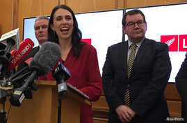 New Zealand Labour leader Jacinda Ardern smiles as she speaks to the press after leader of New Zealand First party Winston Peters announced his support for her party in Wellington, New Zealand, Oct. 19, 2017.