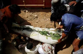 Shiite rebels known as Houthis, bury a fellow Houthi, who was killed in a suicide bomb attack during his funeral in Sana'a, Yemen, Sept. 4, 2015.