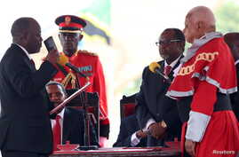 Tanzania's President-elect John Magufuli (L) takes the Oath of Office during his inauguration ceremony at the Uhuru Stadium in Dar es Salaam, Nov. 5, 2015.