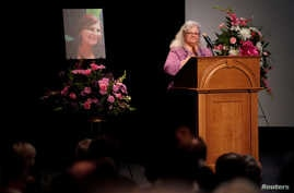 Car attack victim Heather Heyer's mother Susan Bro receives a standing ovation during her remarks at a memorial service for her daughter at the Paramount Theater in Charlottesville, Virginia, Aug. 16, 2017.