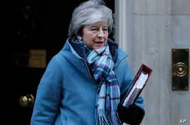 Britain's Prime Minister Theresa May leaves 10 Downing Street for the House of Commons for her weekly Prime Minister's Questions in London, Jan. 30, 2019.