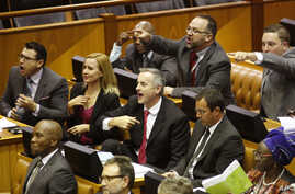 South African lawmakers are seen reacting during a parliamentary session, in Cape Town, South Africa, April 5, 2016.