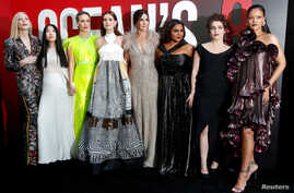 """FILE - Cast members, left to right, Cate Blanchett, Awkwafina, Sarah Paulson, Anne Hathaway, Sandra Bullock, Mindy Kaling, Helena Bonham Carter and Rihanna pose at the world premiere of the film """"Ocean's 8"""" at Alice Tully Hall in New York City, New Y"""