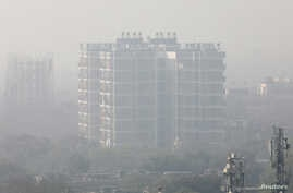 A residential building is shrouded in smog in New Delhi, India, Dec. 25, 2018.