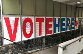 A 'Vote Here' sign marks the entrance on Sept. 20, 2018, to an early voting station in downtown Minneapolis.