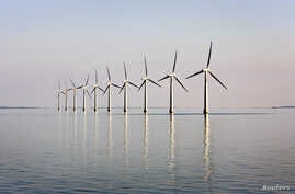 FILE - An off-shore wind farm stands in the water near the Danish island of Samso, May 19, 2008.